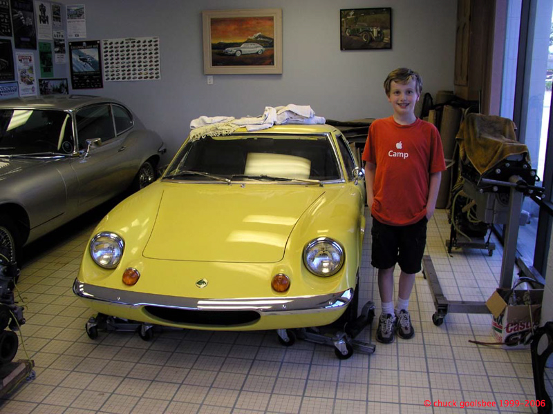 Age 11. Posing with a Lotus at English Classic Cars in Chilliwack, BC.